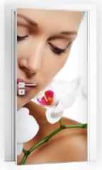 Naklejka na drzwi - Skin treatment for beauty adult woman