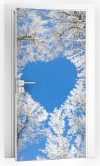 Naklejka na drzwi - Winter landscape,branches form a heart-shaped pattern
