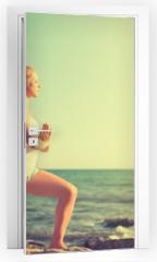 Naklejka na drzwi - young woman doing yoga on  beach