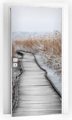 Naklejka na drzwi - Boardwalk with frozen reeds