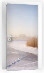 Naklejka na drzwi - Dutch windmills in a foggy winter landscape in the morning