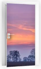 Naklejka na drzwi - After sunset colorful sky over fields
