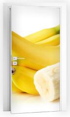 Naklejka na drzwi - bananas isolated on the white background
