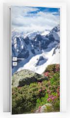 Naklejka na drzwi - Beautiful flowers with Alps mountains.
