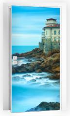 Naklejka na drzwi - Boccale castle landmark on cliff rock and sea. Tuscany, Italy. L