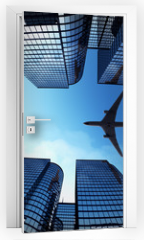 Naklejka na drzwi - Business towers with a airplane silhouette