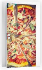 Naklejka na drzwi - Family takes pieces of pizza