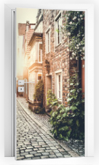 Naklejka na drzwi - Historic street in Europe at sunset with retro vintage effect