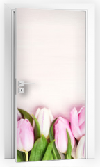Naklejka na drzwi - Pink and white tulips border on pink background. Copy space, top view. Holiday background