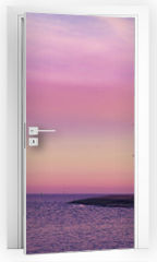 Naklejka na drzwi - Purple sunrise over Baltic Sea coast.