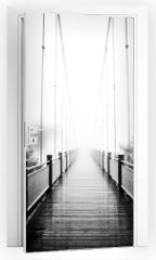 Naklejka na drzwi - view on pedestrian wooden bridge in mist