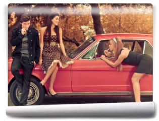 Fototapeta - 60s or 50s style image young people with car