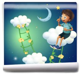 Fototapeta - A boy sitting at the cloud