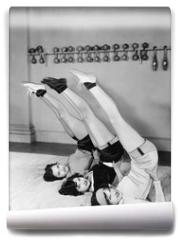 Fototapeta - Three women exercising