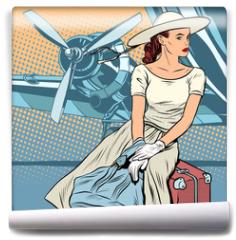 Fototapeta - Lady traveler at the airport