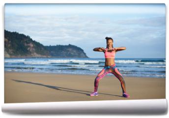 Fototapeta - Sporty brazilian woman dancing and having fun at the beach. Black happy dancer enjoying music rhythm.