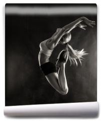 Fototapeta - Fitness female woman with muscular body jumping .