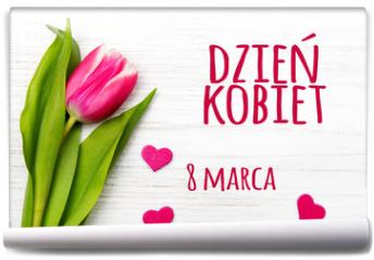 Fototapeta - Women's day card with Polish words DZIEŃ KOBIET. Tulip flower small hearts on white wooden background.