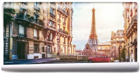 Fototapeta - The eifel tower in Paris from a tiny street