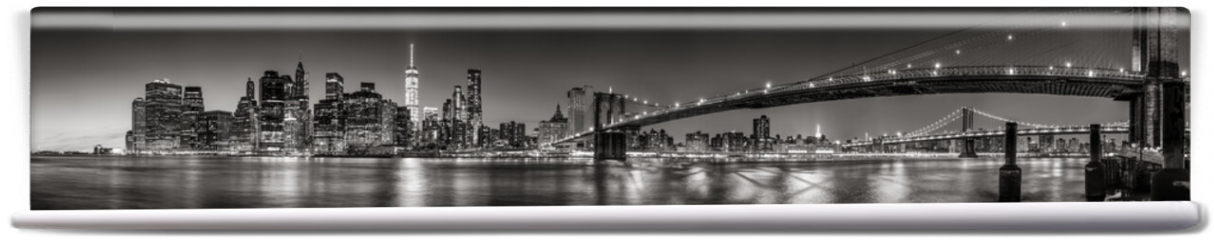 Fototapeta - Panoramic Black and white view of Lower Manhattan Financial District skyscrapers at twilight with the Brooklyn Bridge and East River. New York City