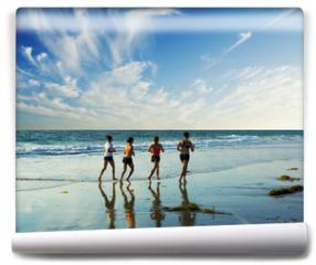 Fototapeta - jogging along the surf