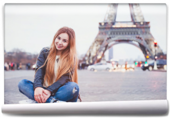 Fototapeta - smiling happy beautiful woman tourist in Paris looking at camera, portrait of caucasian girl near Eiffel Tower