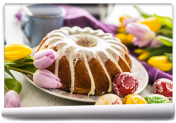 Fototapeta - Easter Cake. Traditional ring marble cake withe easter decotation. Easter eggs and spring tulips.