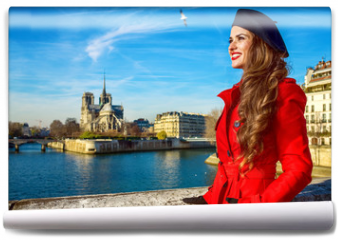 Fototapeta - tourist woman in red trench coat in Paris, France looking aside