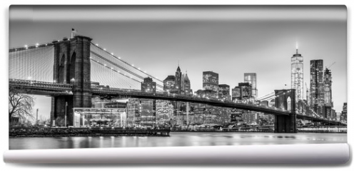 Fototapeta - Brooklyn bridge and New York City Manhattan downtown skyline at dusk with skyscrapers illuminated over East River panorama. Panoramic composition.