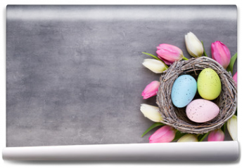 Fototapeta - Pink tulip with pink eggs nest on a gray background. Easter greetings card.