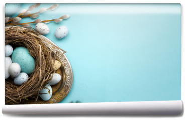 Fototapeta -  Easter background with Easter eggs and spring flowers on blue table
