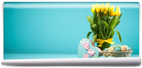 Fototapeta - Yellow tulips on blue background