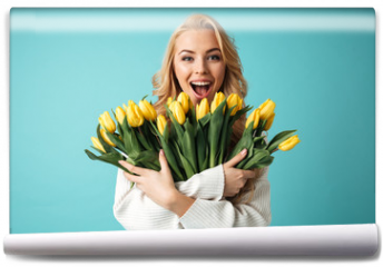 Fototapeta - Portrait of a joyful young blonde woman in sweater