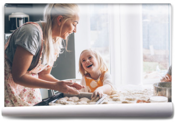 Fototapeta - Mom cooking with daughter on the kitchen