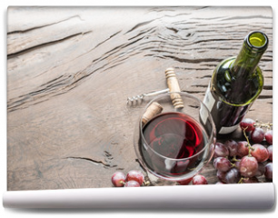 Fototapeta - Wine glass, wine bottle and grapes on wooden background. Wine tasting.