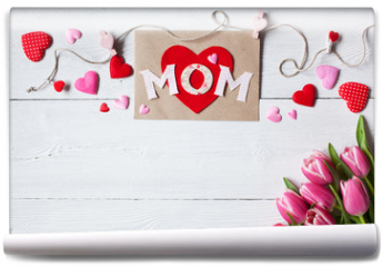 Fototapeta - Background for congratulations for Mother's Day with greeting card, hearts and pink tulips
