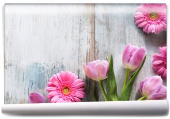 Fototapeta - Tulips and gerbera on gray vintage planks