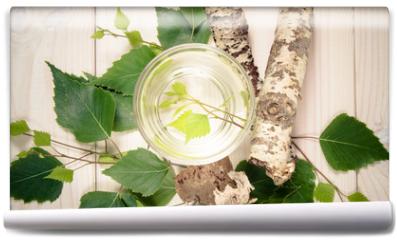 Fototapeta - A glass of birch juice on wooden background