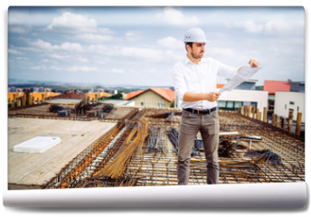 Fototapeta - engineer on construction site working and supervising workers