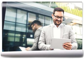 Fototapeta - Businessman using tablet