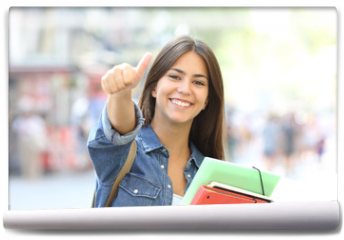 Fototapeta - Happy student posing with thumbs up in the street