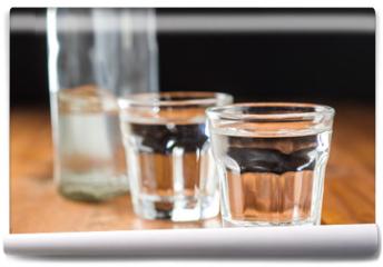 Fototapeta - Vodka in shot glass.