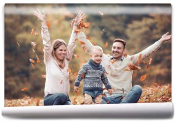 Fototapeta - Happy family having fun in autumn forest