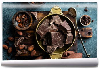 Fototapeta - Dark chocolate pieces crushed and cocoa beans. Chocolate background