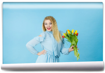 Fototapeta - Pretty woman with red yellow tulips bunch