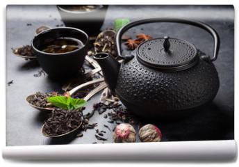 Fototapeta - Various tea in spoons and teapot