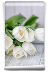Fototapeta - Beautiful white tulips on a light wooden background. Free space