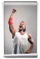 Fototapeta - Athlete with a raised hand celebrates victory