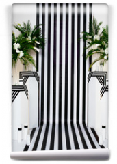 Fototapeta - two vases with flowers on a black and white striped background