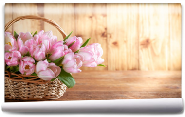 Fototapeta - Easter holiday basket with beautiful pink tulips.